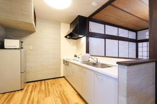 TAMACO in Kanazawaにあるキッチンまたは簡易キッチン