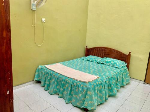 Katil atau katil-katil dalam bilik di Al-Waris Homestay