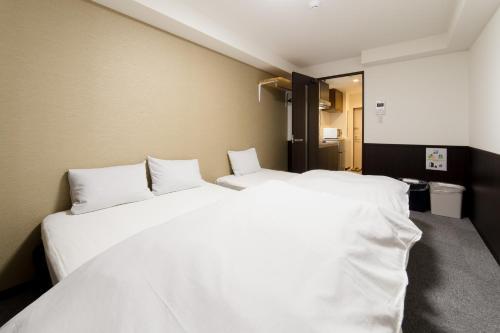 เตียงในห้องที่ Hotel Seagull Palace Abeno