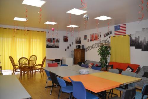 Restaurant ou autre lieu de restauration dans l'établissement Gîte chez la Marie