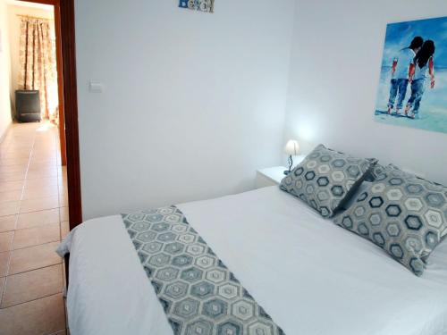 A bed or beds in a room at Apartment Puerto Playa