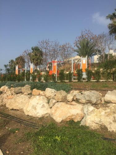 A garden outside Rododafni Beach Apartments