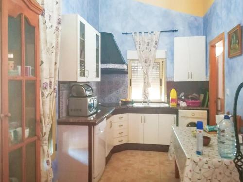 A kitchen or kitchenette at Four-Bedroom Holiday Home in Navares