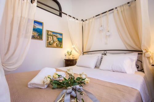Postel nebo postele na pokoji v ubytování La casa di Anna