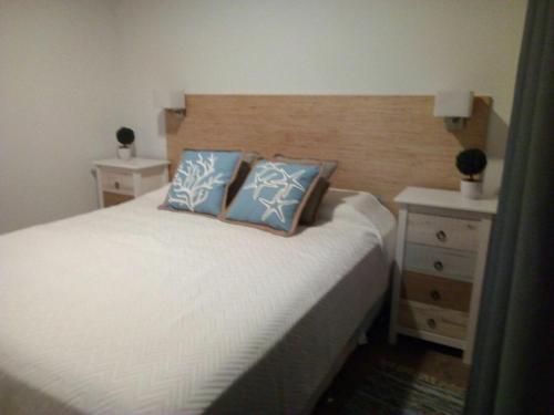 A bed or beds in a room at Hermosa casa en La Paloma