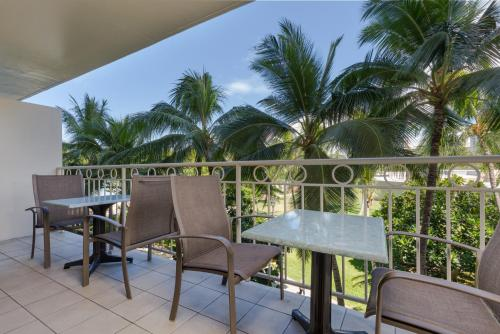 A balcony or terrace at Castle Waikiki Shore Beachfront Condominiums