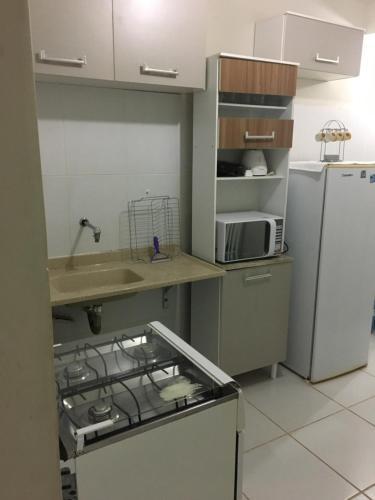 A kitchen or kitchenette at Apartamento Praias do Atlantico