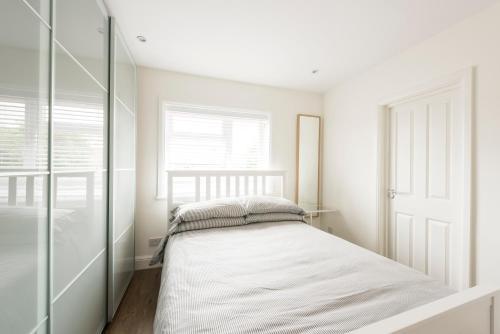 Un ou plusieurs lits dans un hébergement de l'établissement High End Apartments