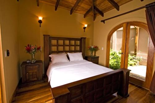 A bed or beds in a room at Recreo Costa Rica