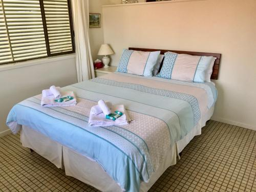 A bed or beds in a room at Beachfront Apt with Private Pool
