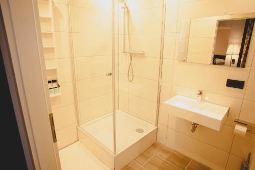 A bathroom at HUXX City