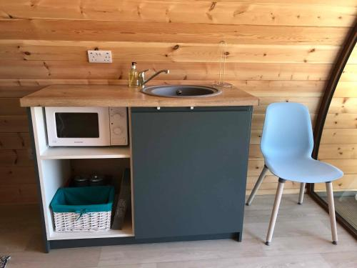 A kitchen or kitchenette at Wild Atlantic Glamping Pod
