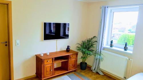 TV/Unterhaltungsangebot in der Unterkunft Ferienwohnung Dahlenwarsleben