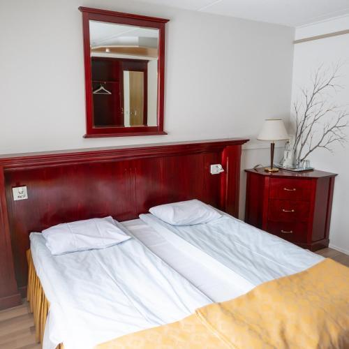 Vuode tai vuoteita majoituspaikassa Lapland Northern Lights hotel Ilveslinna Ranua