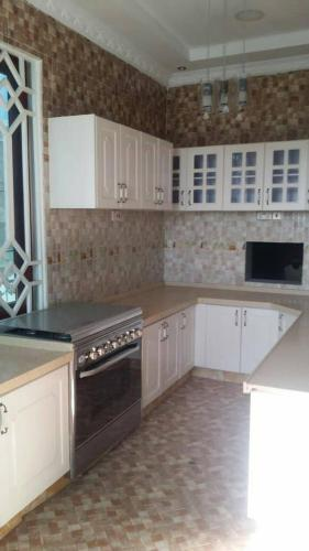 A kitchen or kitchenette at Family Apartment Close to City