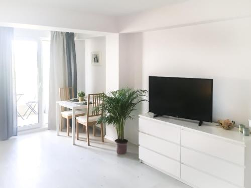 A television and/or entertainment center at Airport Residence - Across from Otopeni Airport