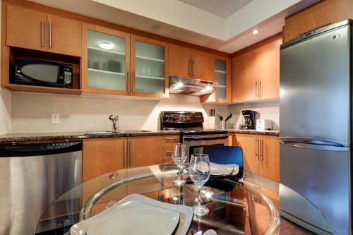 A kitchen or kitchenette at Le Mille-Neuf Cozy Suite