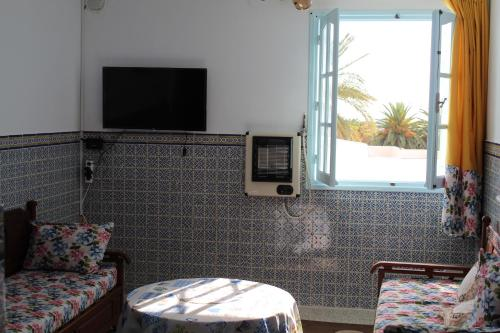 A television and/or entertainment center at City Apartment Mahdia free wifi