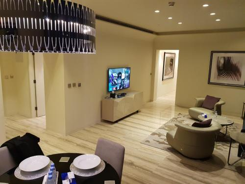 A television and/or entertainment center at Brand New DAMAC Towers Hotel Apartment