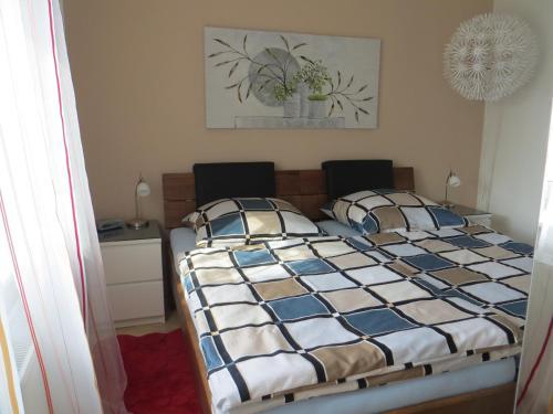 Ein Bett oder Betten in einem Zimmer der Unterkunft Ferienwohnungen Familie Schwarze