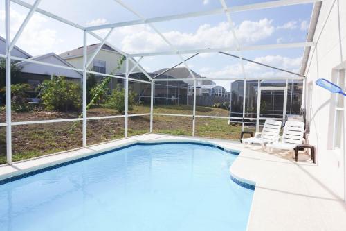 Kolam renang di atau di dekat Disney 4 Bedrooms House with Pool - VH664