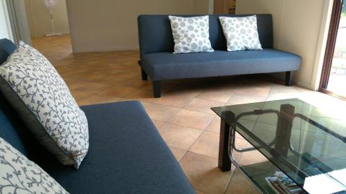 A seating area at Large 6-Bedroom House with Wifi & Netflix Close to Singleton CBD Hunter Valley