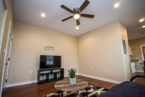 A television and/or entertainment center at Hackberry St #B Renovated 2BR Near Downtown SA