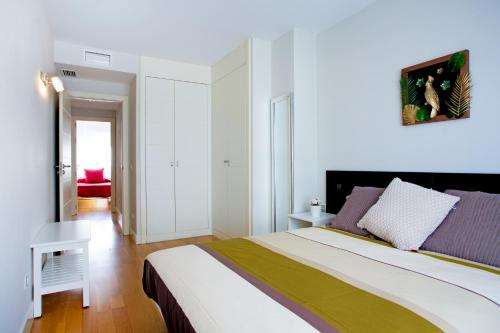 A bed or beds in a room at PYR Select Atocha VIII