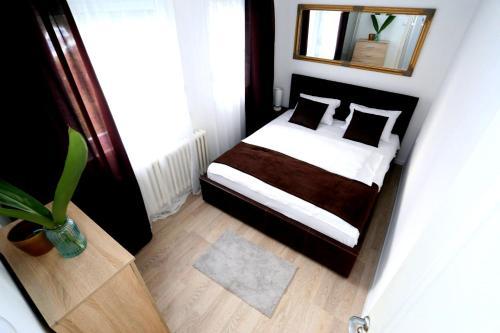 Voodi või voodid majutusasutuse Apartman City Lux toas