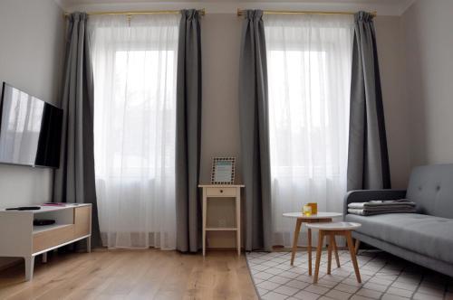 Ein Sitzbereich in der Unterkunft MINT Apartment