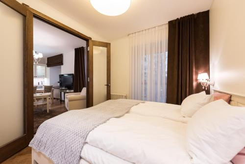 A bed or beds in a room at Sakala 7 LUX Apartment