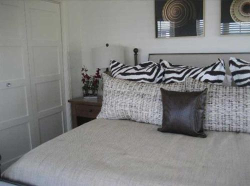 A bed or beds in a room at Chub Cay Resort & Marina - Villa 18