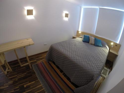 A bed or beds in a room at Mejor imposible!