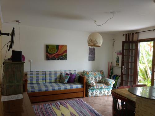 Zona de estar de Lagoa Apartment