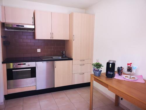 Küche/Küchenzeile in der Unterkunft Petit Paradisli