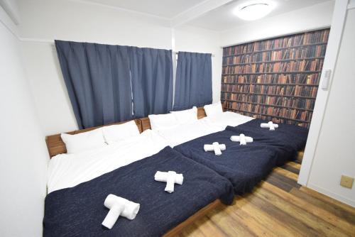 เตียงในห้องที่ Color Nipponbashi