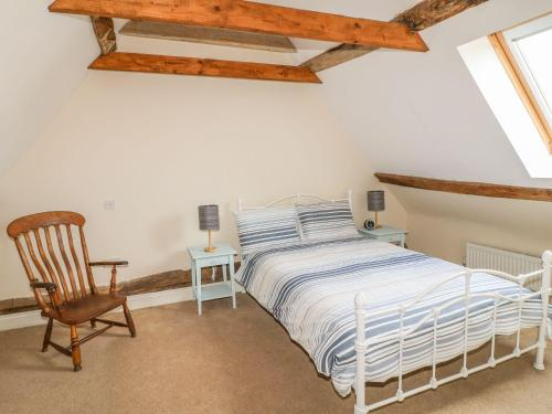 A bed or beds in a room at Millstone, Kettering