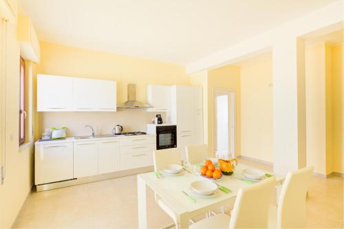 A kitchen or kitchenette at Domus Iose Seaview Apartment