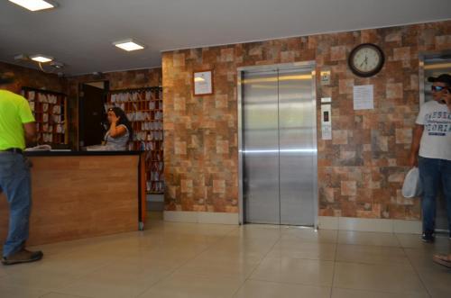 El vestíbulo o zona de recepción de Departamentos Amoblados Paz