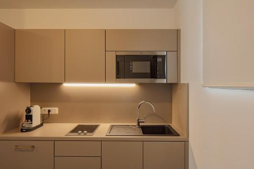 A kitchen or kitchenette at DD Suites Serviced Apartments