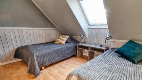 Een bed of bedden in een kamer bij Apelviken Lägenhetshotell