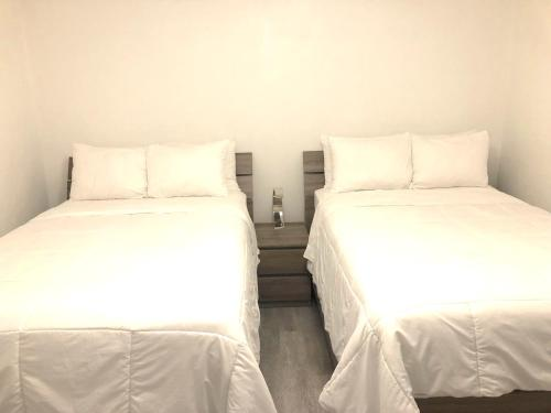 A bed or beds in a room at The Sunset Stay