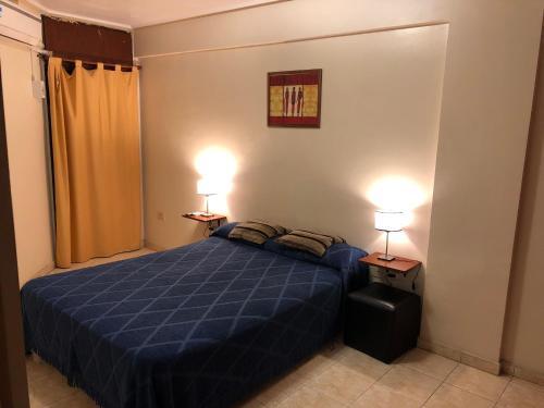 Una cama o camas en una habitación de Catalina Norte