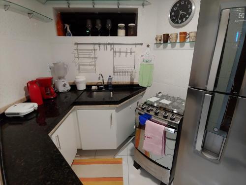A kitchen or kitchenette at Conforto Mariner