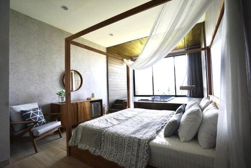 A bed or beds in a room at The cendana villa's