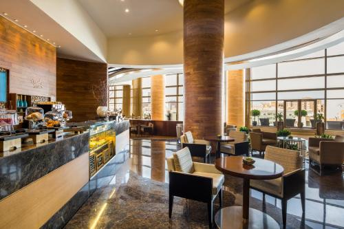 A restaurant or other place to eat at Swissôtel Living Al Ghurair