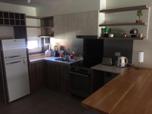 Una cocina o kitchenette en Departamento céntrico UMAIN