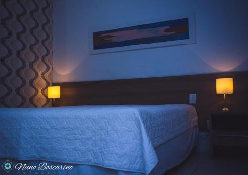 A bed or beds in a room at Deluxe VIP Iguaçu Unique Flats