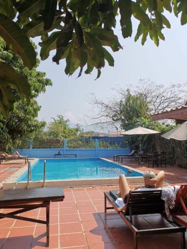 The swimming pool at or near Vang Vieng Garden Bungalow