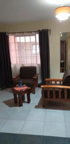 A seating area at Mvuli Studio Suites Nairobi